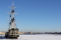 sailboat in a frozen harbor