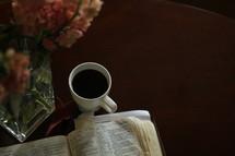 coffee mug and open Bible