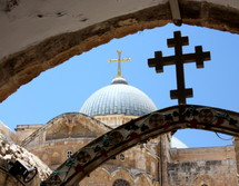 cross topper on The Church of the Holy Sepulcher, called the Church of the Resurrection by Greek Orthodox, in the Holy Land