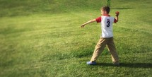 a boy throwing a ball