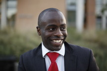 smiling African-American man in a suit