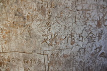Chinese graffiti carvings on an ancient tower wall