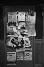 Theatre flyers tacked all over a door.