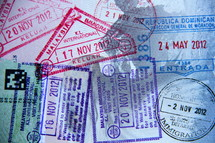 Border crossing stamps in a passport