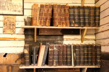 rows of antique books on bookshelves