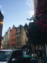 row houses and pedestrians on sidewalks in Scotland