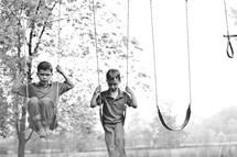 boys on a swing set