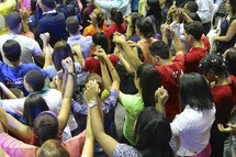 group prayer at a conference worship service