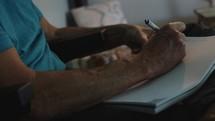 man journaling