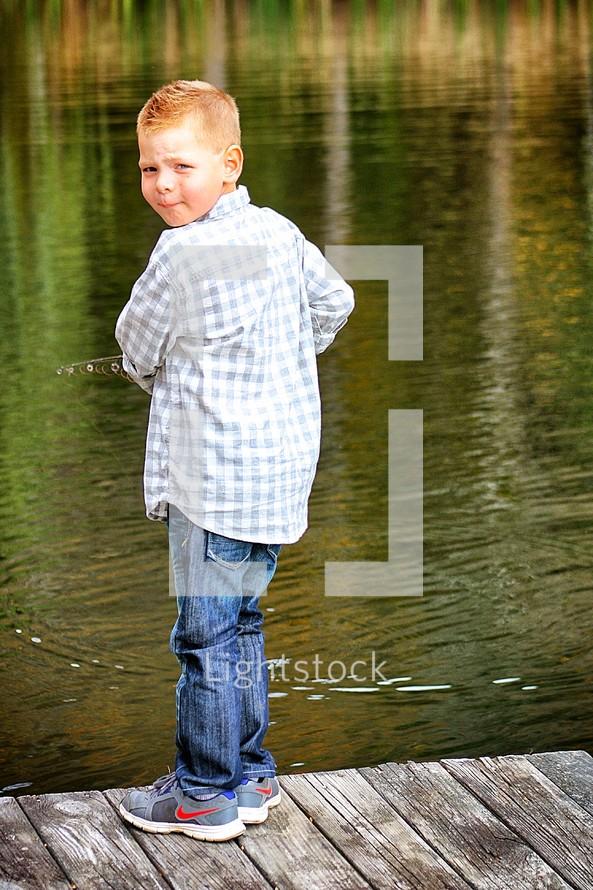boy fishing on a dock