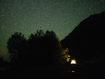 stars in the night sky over a tent