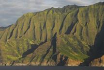 Steep mountains next to the ocean.