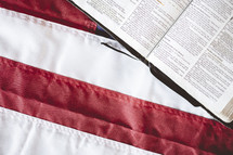 opened Bible on an American flag