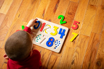 toddler playing with a puzzle