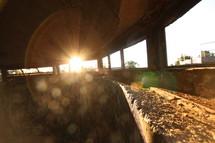 sun shining through windows in a stone building