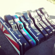 row of guitar cases