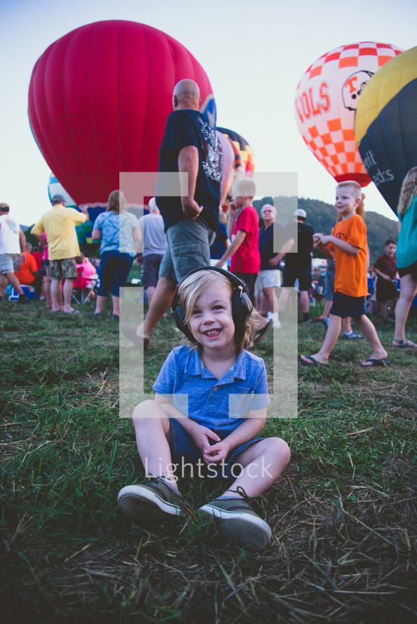 happy child at a hot air balloon festival