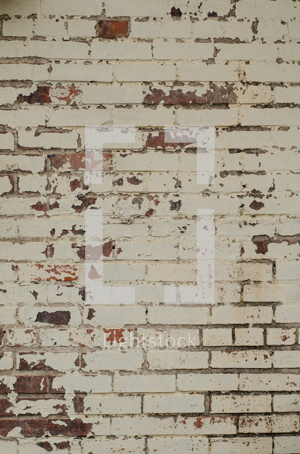 weathered white brick wall