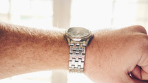 a man's wrist watch