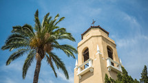 church bell tower and palm tree