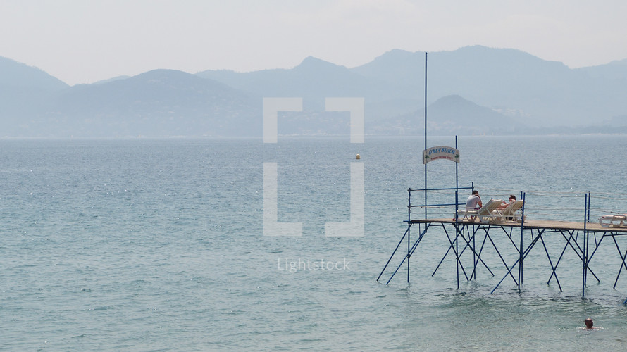 couple resting on a dock