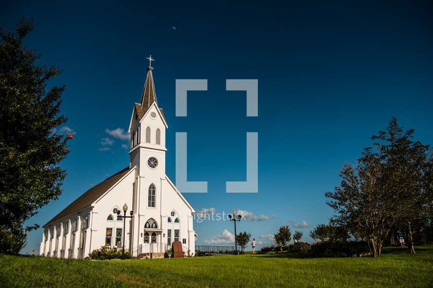 church under a moon in the sky