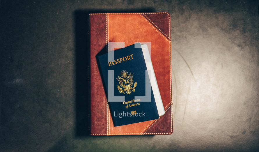passport and leather bound Bible