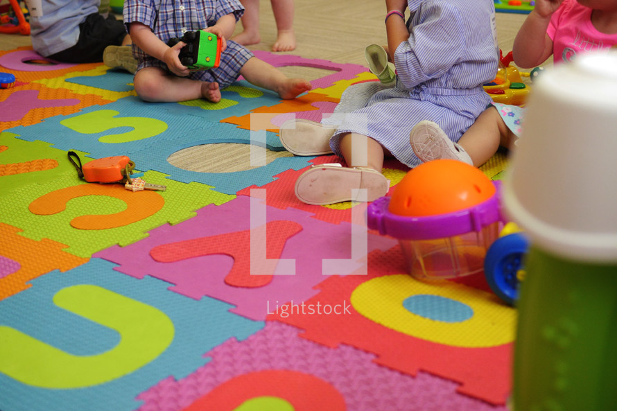 toddlers on an ABC mar at preschool