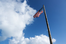American flag flying on a pole.