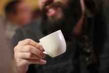 man holding an expresso mug