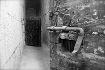 Ancient prison door with lock and viewing hole