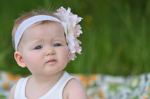 toddler girl with a flower headband