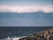 cloud covered mountains by the sea