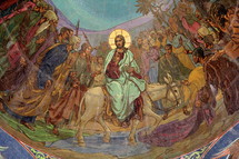 Jesus on a donkey riding into Jerusalem before his crucifixion, death and resurrection.