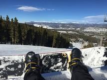 snow boarder on a ski lift