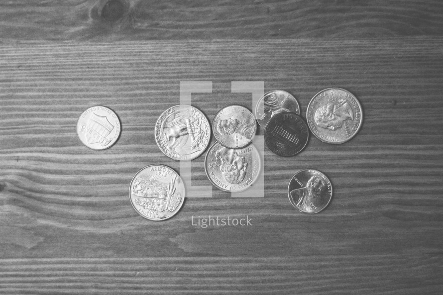 coins on a wood table