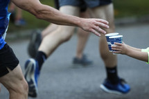 giving water to a runner