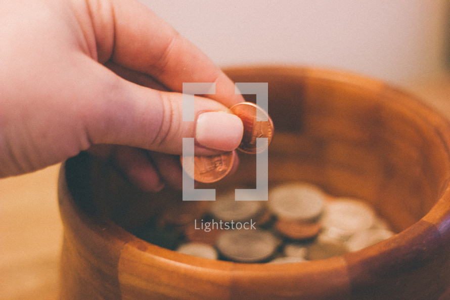 placing coins in a bowl