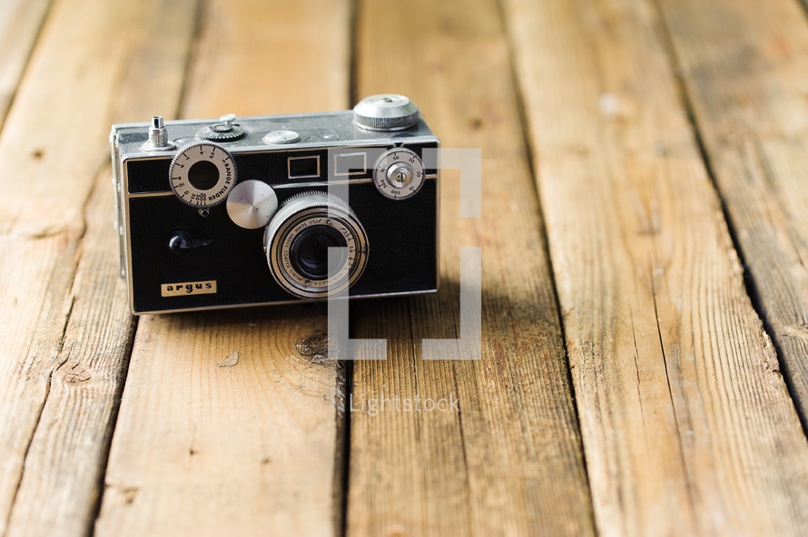 antique camera on a wood floor