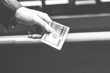 donating money, a twenty dollar bill