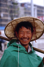Chinese fisherman in a straw hat {Also try search for 'Ethnic Faces'}