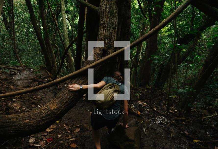 a woman hiking through the jungles