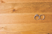 Wedding rings on a wooden table.