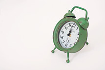 green alarm clock 12:00