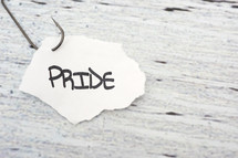 fish hook on paper with the word pride