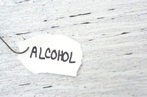 fish hook on paper with the word alcohol