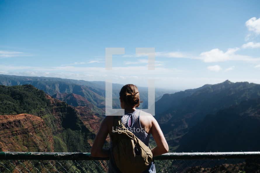 woman looking out a mountain view