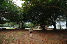 a woman walking through a campgrounds