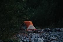 tent on a rocky beach