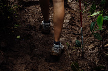 a woman hiking though the jungle